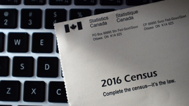 A Statistics Canada 2016 Census sits on the key board of a laptop after arriving in the mail at a home in Ottawa on Monday, May 2, 2016. (THE CANADIAN PRESS/Sean Kilpatrick)