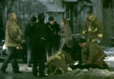 Firefighters attempt to resuscitate a dog that had been electrocuted while walking near in the Keele Street and Dundas Street area on Tuesday, Jan. 1, 2009.