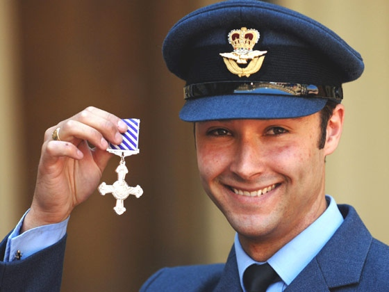 Royal Air Force Chinook pilot Flight Lieutenant Christopher Hasler stands outside Buckingham Palace, London, on May 23, 2007 after collecting his Distinguished Flying Cross from Queen Elizabeth II. (AP / Fiona Hanson)