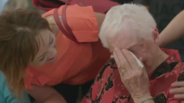 A woman is overcome with emotion when surprised by her loved ones for Mother's Day.