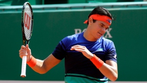 Canada's Milos Raonic gestures during his quarter final match of the Monte Carlo Tennis Masters tournament against Andy Murray of Great Britain, in Monaco, Friday, April 15, 2016. (AP Photo/Lionel Cironneau)