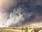 Smoke is seen rising over Fort McMurray on Tuesday, May 3, 2016. Courtesy: Sean Amato