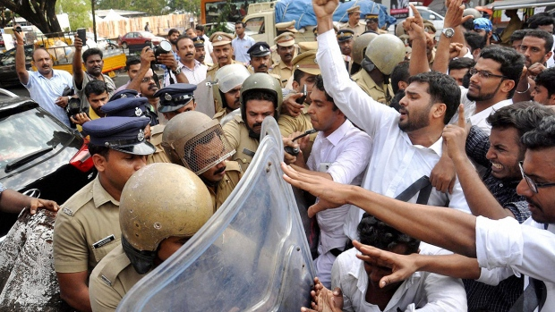 Police stop students who were protesting following the rape and murder of a law student in Kochi, Kerala state, India, Tuesday, May 3, 2016. (Press Trust of India via AP)