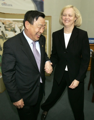 In this 2005 file photo, South Korea's Minister of MCCIE, Lee Hee-Beom is photographed with e-Bay CEO Meg Whitman in Busan, South Korea. (AP / Wally Santana)