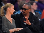 In this April 12, 2015, file photo, actor Eddie Murphy talks with his girlfriend Paige Butcher during an NBA basketball game between the Los Angeles Lakers and the Dallas Mavericks. Murphy and Butcher welcomed their first child together on May 3, 2016. (AP / Mark J. Terrill)