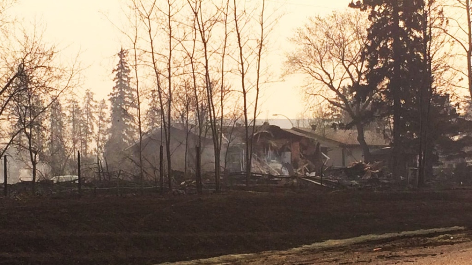 Damaged homes are seen after fire jumped Highway 63 at Hospital Street in Fort McMurray, Alta., on Wednesday, May 4, 2016. (Breanna Karstens-Smith / CTV News)