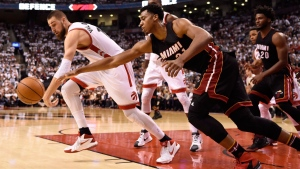 Toronto Raptors' Jonas Valanciunas controls a rebound as Miami Heat's Hassan Whiteside (21) defends during game one second round NBA playoff basketball action against in Toronto on Tuesday, May 3, 2016. THE CANADIAN PRESS/Frank Gunn