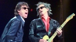 "Mick Jagger, left, and Keith Richards perform ""Jumping Jack Flash"" during the Rolling Stones' No Security Tour performance at the Fleet Center in Boston on March 22, 1999.  (AP Photo/Elise Amendola, File)"