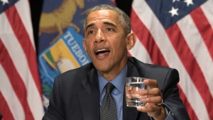 President Barack Obama drinks a glass of filtered Flint water during a meeting with Federal officials at the Food Bank of Eastern Michigan in Flint, Mich. on Wednesday, May 4, 2016. (Daniel Mears/The Detroit News via AP, Pool)