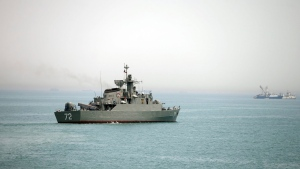 In this Tuesday, April 7, 2015, file photo released by the semi-official Fars News Agency, Iranian warship Alborz, foreground, prepares before leaving Iran's waters, at the Strait of Hormuz. (AP / Fars News Agency, Mahdi Marizad)