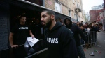 Toronto rapper Drake leaves a Queen St. West pop up shop where he was handing out T-shirts to promote his upcoming album in Toronto on Sunday, April 24, 2016. (THE CANADIAN PRESS/Cole Burston)