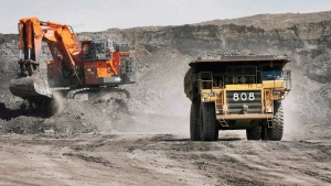 A haul truck carrying a full load drives at the Shell Albian Sands oilsands mine near Fort McMurray, Alta., on July 9, 2008. Shell Canada has closed its oilsands mining operations due to a wildfire. (THE CANADIAN PRESS/Jeff McIntosh)