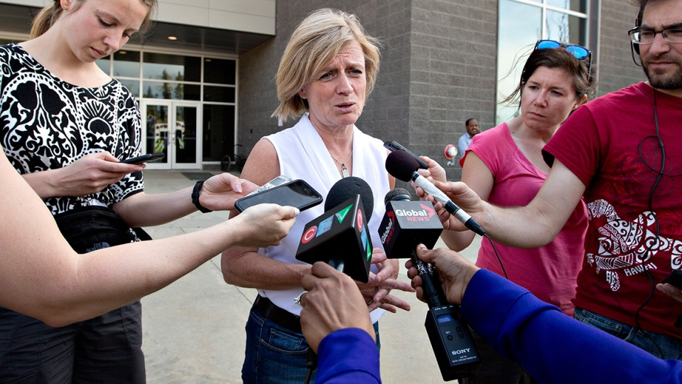 Alberta Premier Rachel Notley speaks with media about the wildfires in Fort McMurray, Alta., on Wednesday May 4, 2016. (Jason Franson / THE CANADIAN PRESS)