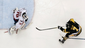 Pittsburgh Penguins' Matt Cullen gets a shot under the pads of Washington Capitals goalie Braden Holtby for a goal in the second period of an NHL hockey Stanley Cup Eastern Conference semifinals against the Pittsburgh Penguins in Pittsburgh on Wednesday, May 4, 2016. (AP / Gene J. Puskar)