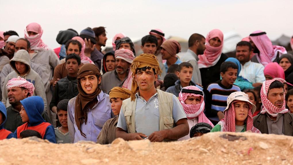 Syrian refugees at the Syrian-Jordanian border