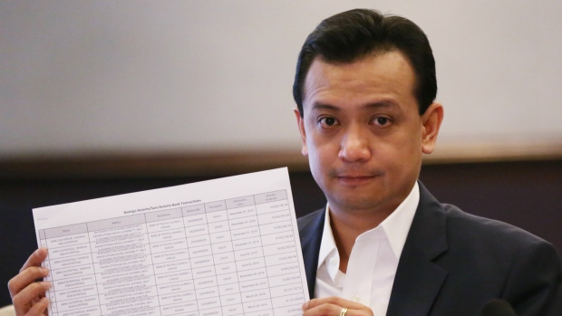 Philippine senator and vice presidential candidate Antonio Trillanes IV shows alleged joint bank account records by presidential candidate Rodrigo Duterte and his daughter Sara during a forum with the Foreign Correspondents of the Philippines in Manila, Philippines on Tuesday, May 3, 2016. (AP / Aaron Favila)