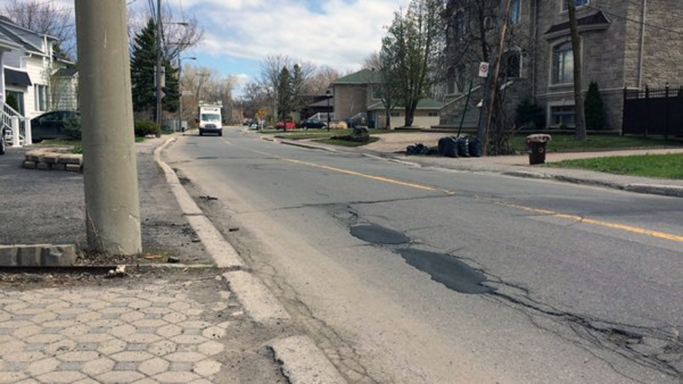 Utility poles in sidewalks and a plethora of potholes made Gouin Blvd. East the worst road in Montreal, according to CAA-Quebec (CTV Montreal/Tania Kyrwiak)