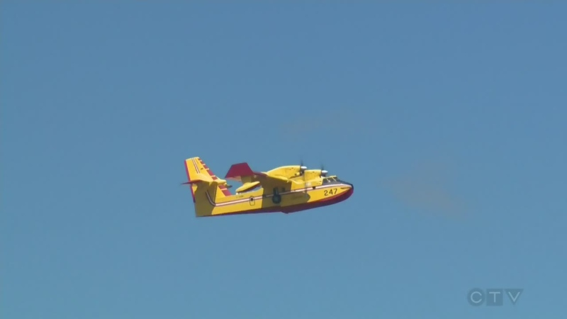 A SOPFEU water bomber flies out of Quebec on May 5, 2016