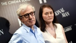 In this July 15, 2015, file photo, director Woody Allen and wife Soon-Yi Previn attend a special screening of 'Irrational Man', hosted by The Cinema Society and Fiji Water, at the Museum of Modern Art in New York. (Photo by Evan Agostini / Invision / AP, file)