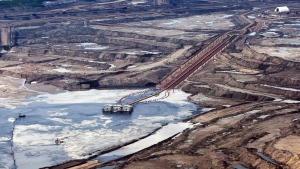 An oil sands facility seen from a helicopter near Fort McMurray, Alta., on July 10, 2012. (THE CANADIAN PRESS / Jeff McIntosh)