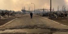 RCMP officer surveys Fort Mac damage