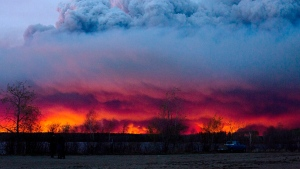 A wildfire moves towards the town of Anzac from Fort McMurray, Alberta., on Wednesday May 4, 2016. (Jason Franson / The Canadian Press via AP)
