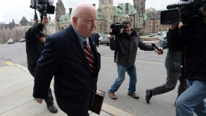 Senator Mike Duffy returns to Parliament Hill in Ottawa on Monday, May 2, 2016. (THE CANADIAN PRESS/Sean Kilpatrick)