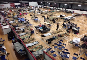 Cots litter the gym floor at an evacuee reception centre set up and operated by the regional municipality of Wood Buffalo in Anzac, Alta., on Wednesday, May 4, 2016. (THE CANADIAN PRESS / Greg Halinda)