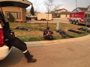 Strathcona  County Professional Firefighters get a brief rest from battling the Fort McMurray blaze in this image posted to Twitter on Thursday, May 5, 2016. (Strathconca County Emergency Services / Twitter)