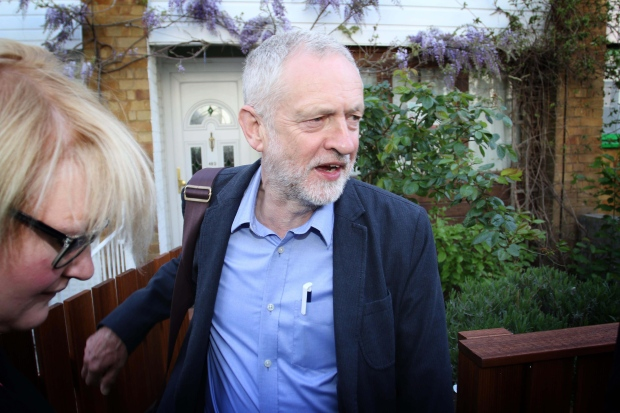 Labour party leader Jeremy Corbyn leaves his home in Islington, north London, Friday May 6, 2016. Voters punished the opposition Labour Party in Scotland as the first results rolled for local and regional elections across the United Kingdom. The elections are being seen as a test of the popularity of party leaders only weeks before Britons vote on a critical referendum on whether the country should remain in the EU. (Rick Findler/PA via AP) UNITED KINGDOM OUT NO SALES NO ARCHIVE