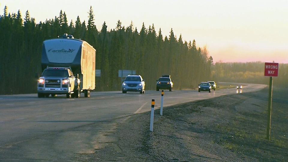 A convoy leaves Fort McMurray, Friday, May 6, 2016.