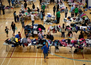 Evacuees from the Fort McMurray wildfires collect donated necessities at the evacuation centre in Lac la Biche, Alta., Thursday, May 5, 2016. (Jeff McIntosh / THE CANADIAN PRESS)