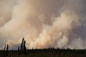 Smoke rises as a wildfire burns near Fort McMurray, Alta., on Thursday, May 5, 2016. An ever-changing, volatile situation is fraying the nerves of residents and officials alike as a massive wildfire continues to bear down on the Fort McMurray area of northern Alberta. THE CANADIAN PRESS/Jason Franson