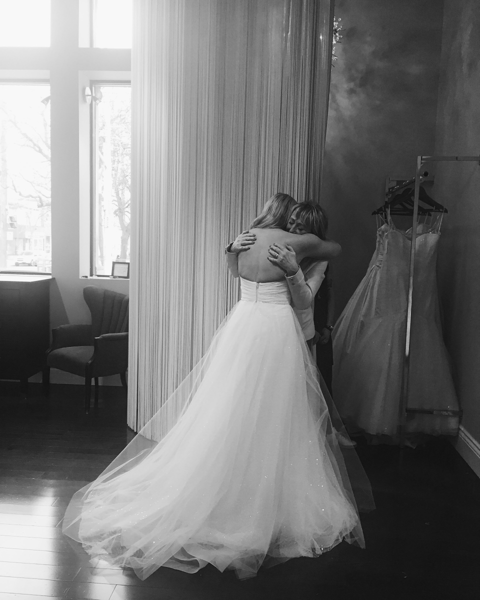 Élise Boissonneult gets emotional as she tries on a wedding dresses at Toronto's Lea-Ann Belter Bridal. (Alex Neary / Wild Eyed Photography)