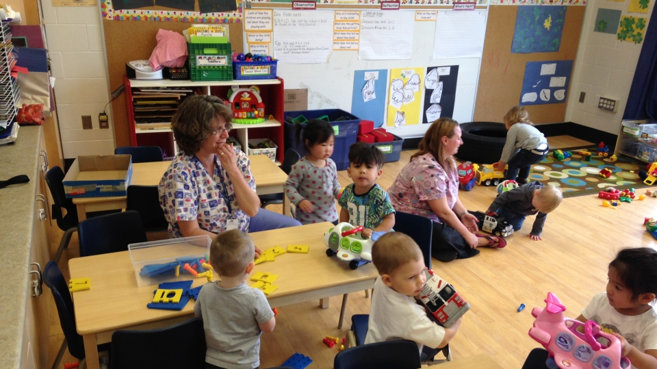 Children and workers are seen at a daycare centre. (Tyler Calver / CTV Kitchener)