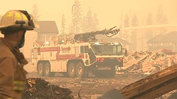 Firefighters continue to work in Fort McMurray to protect infrastructure and save as many homes as possible from the fires.