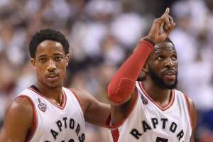 Toronto Raptors' DeMar DeRozan and DeMarre Carroll celebrate after Carroll heads to the foul line against the Miami Heat during overtime NBA playoff basketball action in Toronto on Thursday, May 5, 2016. (The Canadian Press/Frank Gunn)
