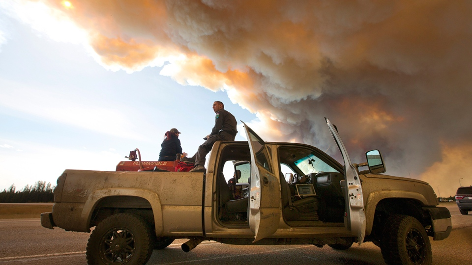 Animal rescue workers wait to get entry to Fort McMurray, Alta., on Friday, May 6, 2016. (Jason Franson / THE CANADIAN PRESS)
