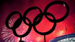 The Olympic Rings are silhouetted as fireworks light up the sky during the closing ceremonies at the 2014 Sochi Winter Olympics in Sochi, Russia on Sunday, February 23, 2014. THE CANADIAN PRESS/Nathan Denette