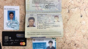 In this photo released by the Egyptian Ministry of Interior on Thursday, Mar. 24, 2016, personal belongings of slain Italian graduate student Giulio Regeni, including his passport, are displayed. (Egyptian Interior Ministry via AP)