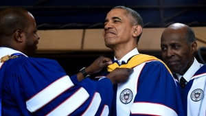 Howard University President Wayne A.I. Frederick, left, adjusts the sash of President Barack Obama, center, as he is awarded an honorary Doctor of Science degree from Howard University in Washington, Saturday, May 7, 2016, by Vernon Jordan, right. (AP / Susan Walsh)