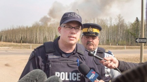 RCMP Inspector Kevin Kunetzki updates the media on the highway to Fort McMurray, Alta., as wildfires are still burning out of control, Saturday, May 7, 2016. THE CANADIAN PRESS/Ryan Remiorz