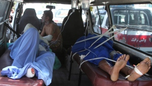 Injured Afghan men lie in an ambulance after an accident on the main highway linking the capital, Kabul, to the southern city of Kandahar, in Ghazni province eastern of Kabul, Afghanistan, Sunday, May 8, 2016. (AP / Rahmatullah Nikzad)