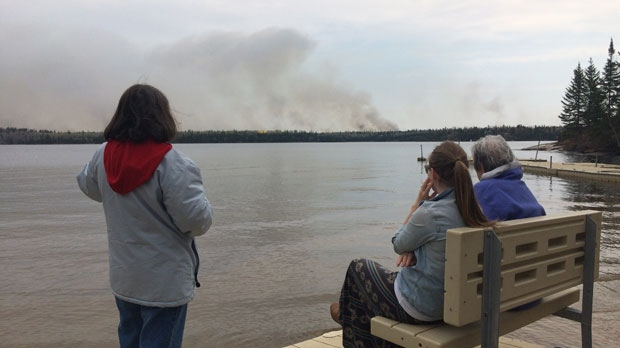 Lynne McNicholl and locals watch the fires at Caddy Lake.