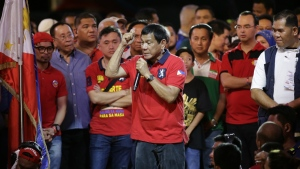 Philippine presidential race front-runner Davao city mayor Rodrigo Duterte gestures to the crowd during his final campaign rally in Manila, Philippines on Saturday, May 7, 2016. (AP / Aaron Favila)