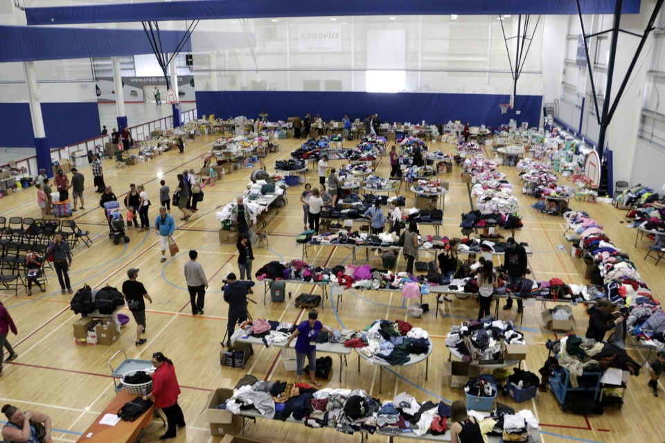Wildfire evacuees sort through clothes and other items at an evacuation center in Lac La Biche, Alberta, Saturday, May 7, 2016. (AP Photo/Rachel La Corte)