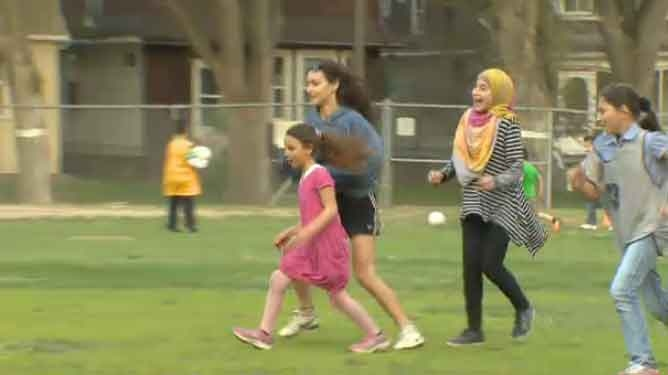 This year, with the help of friends and community members, Rahimi has expanded the football club to include children ages 5 to 14.