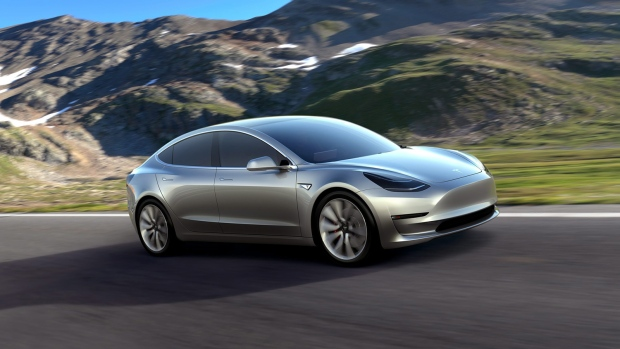 This undated photo provided by Tesla Motors shows the Model 3 car. (Tesla Motors via AP)