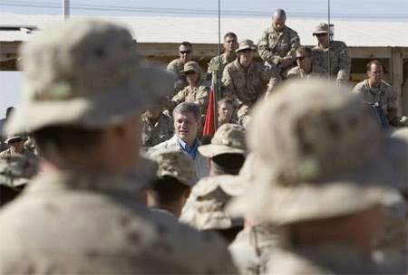Prime Minister Stephen Harper delivers a speech to Canadian troops at Kandahar airfield in Kandahar, Afghanistan on Wednesday, May 23, 2007.(CP / Tom Hanson)