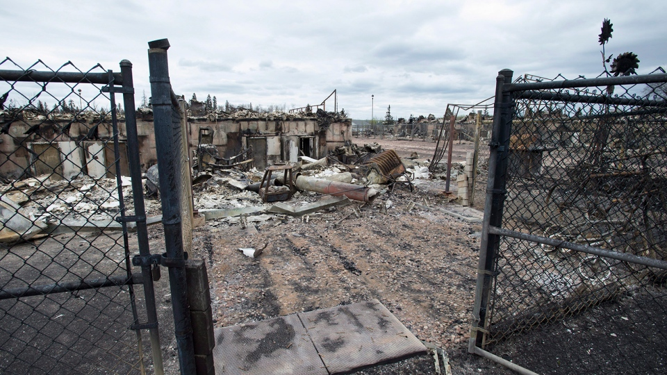 The burnout remains of a home in the Abasands neighbourhood is seen during a media tour of the fire-damaged city of Fort McMurray, Alta., on Monday, May 9, 2016. (Jonathan  Hayward / THE CANADIAN PRESS)